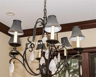 An American Wrought Iron and Leaded Glass Drop Six Light Chandelier.                                                                                        Dimensions: H 26 x D 30 inches approximately.                    $750.00