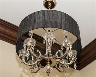 An American Eight Light Glass and Leaded Drop Chandelier.                                                                                                    Dimensions: H 20 x D 24 inches.                                                        $425.00