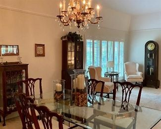 Glass top dining pedestal table with 8 chairs, chairs and table can be purchased separately