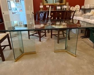 beautiful beveled glass top on glass and chrome pedestals 40 X 76, seats 8 chairs comfortably $695.