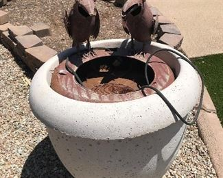 water fountain with 2 crows