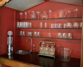 Wet bar. Crystal and silver set retained by family.