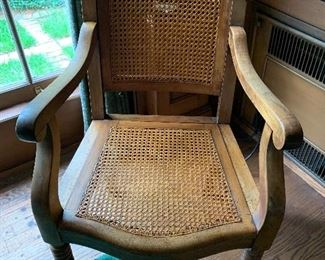 Unique adjustable back caned chair