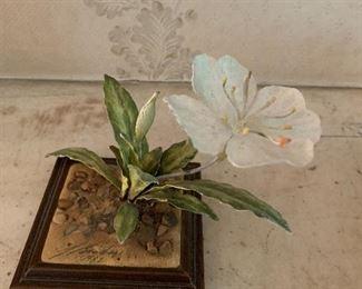 One of two enamel flowers