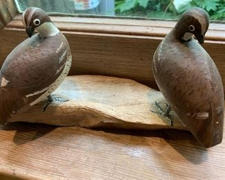Carved and painted birds