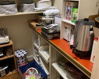 The pantry -Kitchen Aid mixer; lots of small kitchen appliances