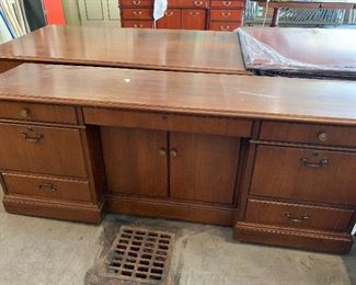 One of a pair of massive executive credenzas