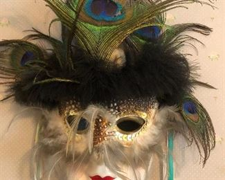 collection of porcelain and Mardi Gras type masks