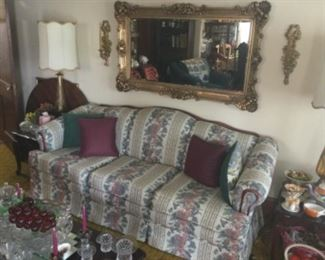 Floral Couch With A Beautiful Large Gold Mirror And Sconces