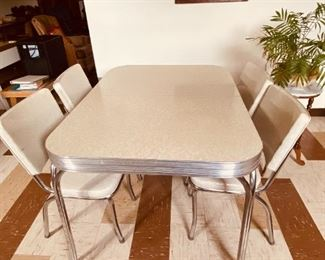 Mid Century Chrome Dinette Set with four chairs and a leaf