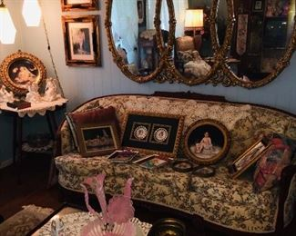 Parlor filled with 1930's upholstered furniture, mirrors, swag lights, Fenton glass, painted plaques