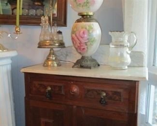 Lamp, marble topped washstand & castor set