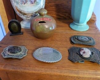 Early belt buckles and Cole pottery bank