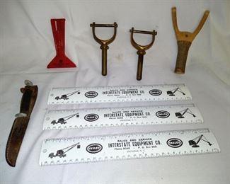 Brass oar locks, sling shot, advertising rulers