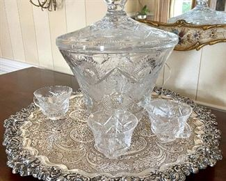 Stunning crustal punchbowl with cups...makes for a stunning centerpiece!