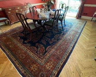 Henkel Harris dining table and chairs, divine antique oriental rug and sideboards.