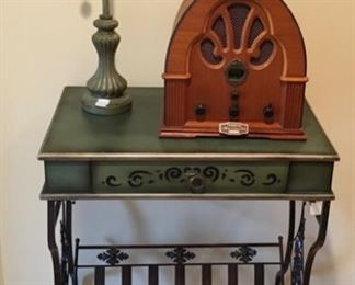 Green top wood table with metal base. Antique style Cathedral radio