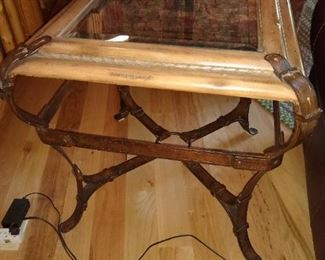 Oak coffee table with glass and wrought iron buckle straps.