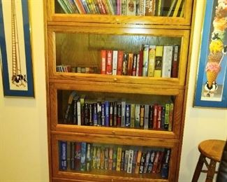Antique Oak lawyers bookshelf with five shelves and glass fronts.