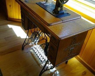 Christine Singer sewing machine in Oak cabinet.