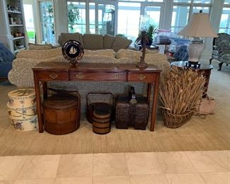 Traditional sofa table with just a few of the beautiful baskets