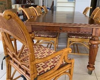Large farm style dining table - seats 8. Shown with rattan chairs