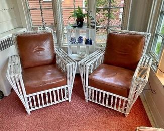 Vintage stick wicker chairs, one with magazine holder.