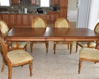 """Dining Room Table & Six Oval Back Chairs. Grand Cayman set purchased at Haverty's Fine Furniture. 48"""" wide x 31"""" h x 77"""" long plus two 18"""" Leaves. Seats are protected by Guardsman. Clean and looks like new."""