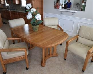 Douglas Furniture Table w/ Leaf and 4 Chairs. Chairs tilt back and roll. Super comfortable set. Over $2,000 new. $400
