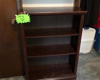 Heavy wood bookcase.