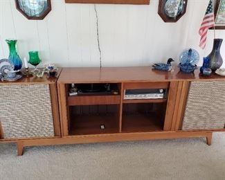 Barzilay (presumed) 4 piece stereo console cabinet with tambour doors. Speakers and central console piece are all separate pieces which sit on the base. This item may be available for pre-sale. Contact us for an appointment to view it.