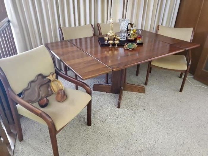 Stunning, rare vintage Koa wood table with 2 leaves and 4 chairs. Hawaiian Koa wood has not been allowed to be harvested and exported since the 1970s.