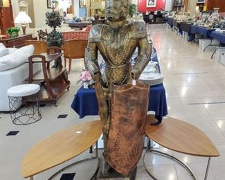 Knight in shining armor!  We have three of these unique tables.