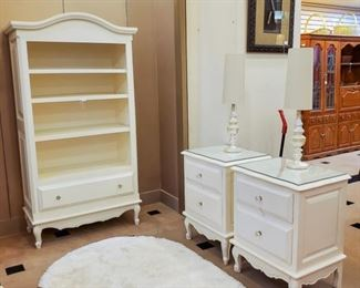LOVE this book case and glass-topped nightstands