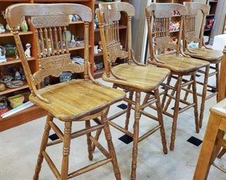 Four very well made oak bar stools