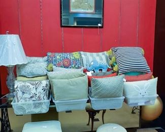Lots of decorative pillows!  Vintage Singer Sewing Stool!  Adorable vanity stool to the right.