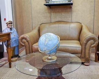 Vintage globe, amazing glass table, leather loveseat!
