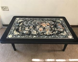 Two low coffee tables with folding legs available.