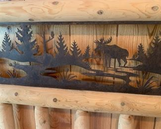 Log Bed $900       Rustic Metal Moose Scene Inlay     Size is Queen. Excellent condition. Made in Traverse City Michigan by a company that also supplies Great Wolf Lodge. Matching nightstands available.             THIS IS A PRESALE ITEM!
