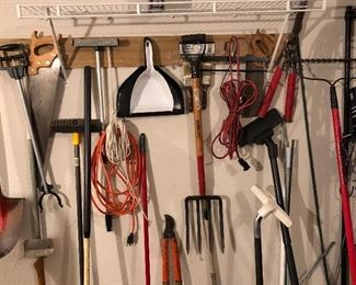 Assorted tools, saws, cords, pitchforks, etc.