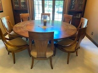 This table is perfect for larger families! Everyone can be around the same table AND see the whole family at once.  This is in pristine condition and has leafs that can be taken out for a smaller table.