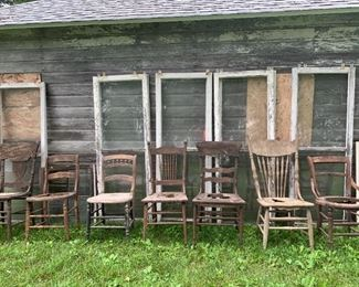 Large selection of windows and chairs, plus metal farm objects