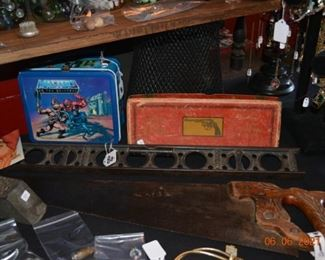 Antique tools and Masters of the Universe Collectibles