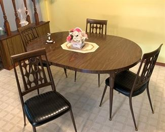 Mid century table and chairs. One leaf currently in table