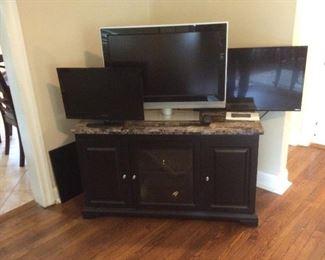 three flat screen TVs , wonderful marble top entrainment center