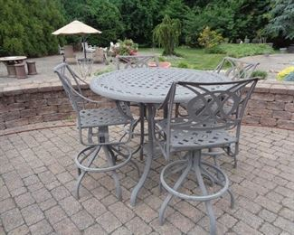 CAST ALUMINUM HIGH TOP WITH 4 SWIVEL  CHAIRS  $700.00