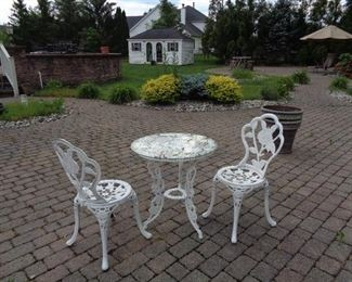 CAST IRON BISTRO TABLE AND 2 CHAIRS
