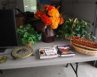 cookbooks and artificial floral greenery