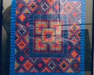 Framed needlepoint mola from San Blas islands with very fine hand-stitching