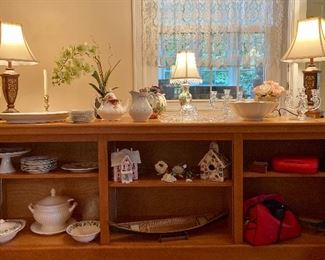 Low wooden bookshelves and all items shown for sale: small antique lamps, decorative objects, pitchers, soup tureen, serving platters, crystal candlesticks, small Lenox bowl, vintage cameras and lenses, much more!